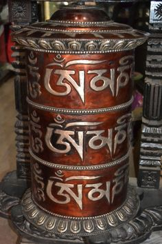 """Prayer wheels are an exclusively Tibetan Buddhist praying instrument and usually bears the mantra """"OM MANI PADME HUM"""". The mantra is in the Sanskrit phonetic. It is the prayer of compassion for the well-being of all sentient beings. 
