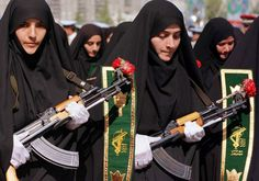 Iranian women mark the 20th anniversary of the start of the Iran-Iraq war during a military parade Photo By: REUTERS