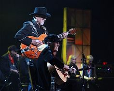 Duane Eddy and Corki Casey O'Dell perform at the 2014 Musicians Hall of Fame Induction Ceremony at Nashville Municipal Auditorium on January 28, 2014 in Nashville, Tennessee.