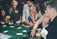 Patrons trying their luck at the blackjack table in the Moulin Rouge casino, Las Vegas, NV, 1955