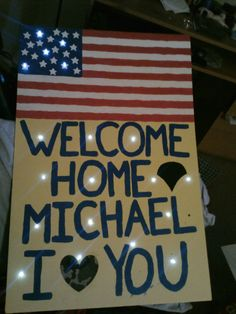 My hubbys welcome home sign that i made using foam poster board, metalic paint, and LED poster lights all materials found at Michaels craft store, Poster took 9 hours because of triple layering of paint and precision on lines