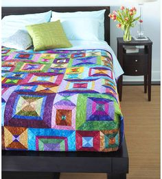 Modern Mix Quilt    Modernize a traditional hourglass block with batiks and seemingly random strip sets. Look closely and you'll see that there is indeed rhyme and reason behind the blocks in this energetic quilt.