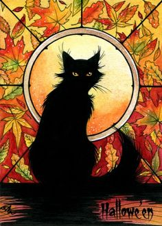 Autumnal black cat