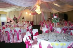 Pink wedding table set up with tall table arrangements