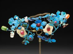 Hairpin with birds, flowers, gilt filigree, seed pearls, semi-precious stones and Kingfisher feathers.  Called Tian-Tsui, Kingfiser feathers are painstakingly cut and glued onto gilt silver, the effect is like cloisonné, but no enamel was able to rival the electric blue color - China  c.19th Century