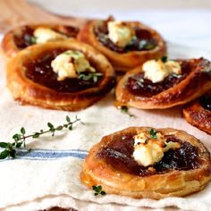 Caramelized onion and feta tartlets drizzled with honey, and a tip for making them for a last minute appetizer! Sub GF flours/pastry