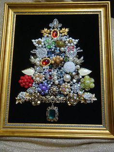 My great grandma and i made one of these together when i was little out of my great-great grandma's jewelry ...Need to do that again. Framed Vintage Costume Jewelry Christmas Tree Lots of Beautiful Twinkle | eBay $60