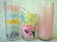 wouldn't a lovely set of mismatched vintage glasses be a way to quench your families thirst?  I love it!
