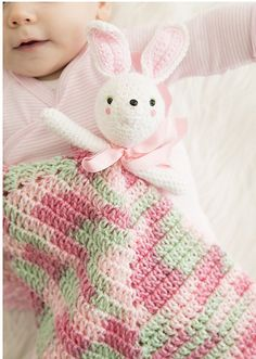 Ravelry: Hop Along Blanket with Bunny Topper pattern by Monica Rodriguez Fuertes.