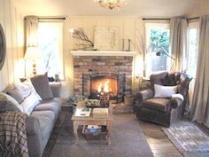 -Cozy living room with beamed ceiling and French antiques. Love the neutral colors.