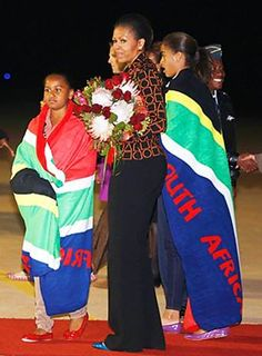 The audacity continues..The Obamas display their colors at the Olympics... Really??? South Africa ??? Gee, ladies, thanks for your support. Hmm, so did tax dollars from South Africa PAY for their trip to the Olympics?!?!? Of course not, OUR tax dollars paid! for the Obamas to represent a country that murdered 70 000 whites with no media comment!