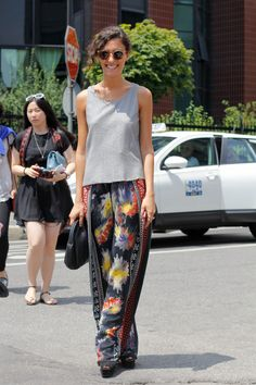 Opt for a more unconventional approach to breezy dressing in silky pants and a tank.