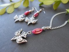 Fuchsia pink mother of pearl peace dove pendant and earrings by CharismaBolivia