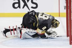 LAS VEGAS, NV - OCTOBER 13: Marc-Andre Fleury #29 of the Vegas Golden Knights is shaken up after colliding with Anthony Mantha #39 of Detroit Red Wings during the game at T-Mobile Arena on October 13, 2017 in Las Vegas, Nevada. (Photo by Jeff Bottari/NHLI via Getty Images)