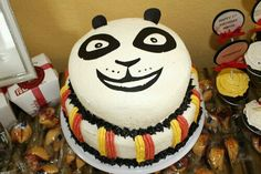 """DIY Kung Fu Panda 2 tier cake. Buttercream icing on simple sponge cake. Smooth out icing using Viva Paper Towels to create the flawless fondant look. I used black """"sugar paper"""" from Michael's for the face & ears. Super easy and fun!"""