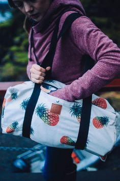 The ultimate weekender duffle is here! The perfect size for weekend getaways, or Costco trips. This bag is simple and chic. Plus, who doesn't love pineapples?! This bag is designed for travelers and a
