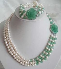 Pearls and says emerald but looks like jade. Love it!