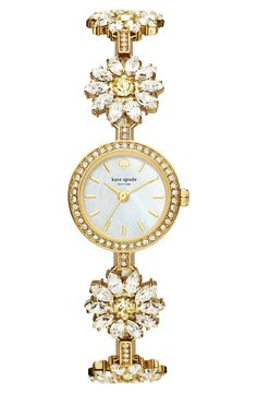 In love with this slender Kate Spade watch with a sparkling floral-modeled bracelet made of crystals.