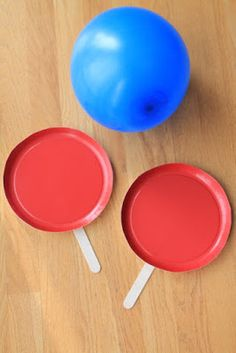 Balloon tennis with paper plate paddles.