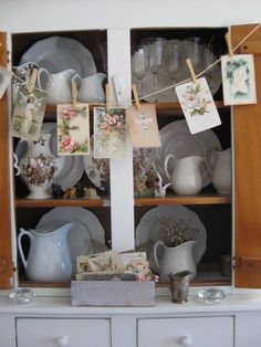 "Charming cottage hutch. Love the vintage cards clothes-pinned ...""hanging out to dry."" #cottagecabinets#hutch"