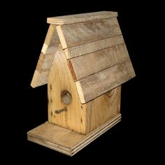 http://www.repotme.com/bird-houses/Wood-Bird-House-Full.html