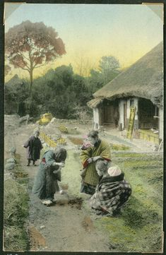 Woman and children in a village, Japan.