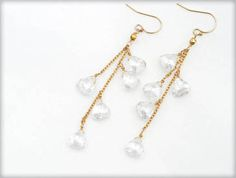 Crystal Gemstone Dangles -- Let yourself shimmer! A dozen crystal's hang from gold chain for a stunning statement. $64.00