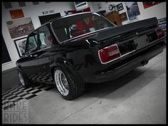 Rare Rides 2002: Black over red, turbo-flares stuffed full o' BBS RS