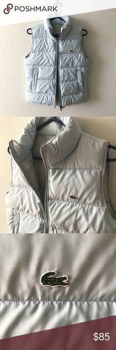 Lacoste Down Puffer Vest baby blue Baby blue Lacoste puffer vest. 100% authentic!  EU Size 36 on the label, which is a Size 4 US.  Flat measurements: 18 inches from armpit to armpit (pictured), 15 inches across the back at the shoulder (pictured), and 23 inch length.  This puffer is 70% down / 30% feather, with a polyester lining. Side pockets both have snap closures (pictured). Lacoste Jackets & Coats Vests
