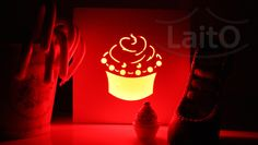 Cupcake. 15cm x 15cm x 3cm. To support on the table or hang on the wall. Color changing LED remote controlled lamp.