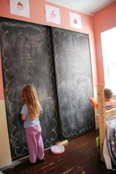 Chalkboard paint on sliding closet doors in the kids' bedroom -- genius.   apartmenttherapy.com