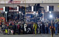 Brad Keselowski, #2 Miller Lite Ford, and Jeff Gordon, #24 Drive To End Hunger Chevrolet, are involved in a fight at the conclusion of the NASCAR Sprint Cup Series AAA Texas 500 at Texas Motor Speedway on November 2, 2014
