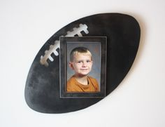 Football picture frame - 5x7 metal wall art frame - 3D photo frame - black and steel picture frame - football picture frame - photo frame by FunctionalSculpture on Etsy https://www.etsy.com/listing/179772694/football-picture-frame-5x7-metal-wall