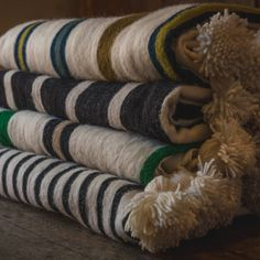 Super warm, hand woven Moroccan pom pom blankets in a selection of stripes.  Guaranteed to keep you warm and cosy this winter.https://maudinteriors.com/product-category/textiles/blankets-and-throws