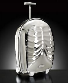 Alexander McQueen's for Samsonite Black Label – in limited edition shining silver for the striking ribcage Hero piece (2008)