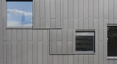 Smooth cladding / panel / for ventilated facades - OFFICE BUILDING TERRA PANONICA - Swisspearl
