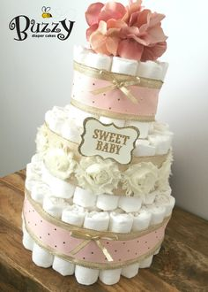 Shabby Chic Blush Pink, Ivory, and Gold 3 Tier Diaper Cake with Blush Pink Blossom Topper . . . At checkout, I will ask for your shower date so that all of my orders are managed appropriately and timely. If you select a date that is LESS THAN 10 DAYS at the time you purchase, it will be considered a Rush Order. See my Rush Order info here: https://www.etsy.com/listing/241362020/rush-order . . .Silk floral toppers or lettering styles/colors on mini signs may var...