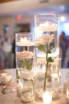Simple Do-It-Yourself Cheap Wedding Centerpieces Ideas - Romantic DIY Floating Candles Crafts Ideas Candle Wedding Centerpieces, Diy Wedding Decorations, Centerpiece Flowers, Floating Candles Wedding, Cheap Table Centerpieces, Floating Flower Centerpieces, Diy Candles, Cheap Table Decorations, Modern Centerpieces