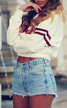 The high waisted jean shorts are classic. ANd that crop top school sweater couldn't be any more fantastic. I want this outfit.. now.