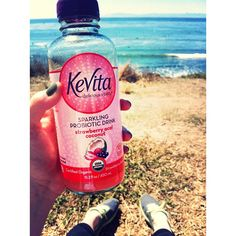 Refreshing with Strawberry Acai Coconut by the beach!