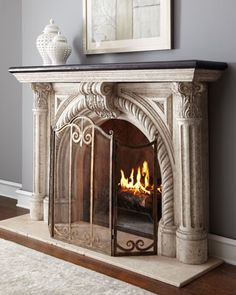 "Rope-Edge Fireplace Mantel Inspired by classic architecture, this mantel makes a distinctive frame for a glowing fire.  Handcrafted of crushed stone/polyester resin/styrene/fibergalss.  Hand-painted weathered-white finish with black top.  Lightweight and durable.  Interior, 33.5""W x 11.5""D x 34.375""T. Exterior, 72""W x 15""D x 50""T.  Imported.  Boxed weight, approximately 268 lbs.      Handcrafted o..."