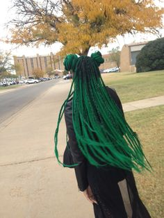 So cute! Dark green micro-braids pulled up into two buns! Sailor moon inspired up-do