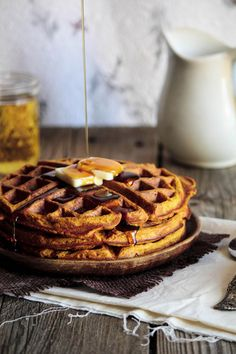 Pumpkin Waffles : 3 tablespoons brown sugar, packed 2 large eggs 1 cup (245 grams) canned (or fresh) pumpkin puree 4 tablespoons (1/2 stick or 57 grams) butter, melted 1 teaspoon vanilla extract 1 cup (237 ml) milk 1 1/2 cups (188 grams) all-purpose flour 2 teaspoons baking powder 2 teaspoons ground cinnamon 1/2 teaspoon ground cloves 1/2 teaspoon ground nutmeg 1/2 teaspoon salt