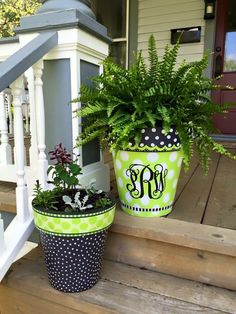 Don't you love these painted pots?  While Many folks are painting their own pots in similar fashion to these, we've been told by one of our readers that Studio M is a god source for pots that are already done.   BUT...if you are feeling artsy, you can do this yourself with some paint and vinyl decal monograms!!!