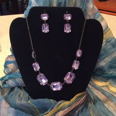 7 Light purple glass stoned necklace & earrings Crystal appearance of shining light purple stones set in this dark gun barrel chain.  Matching pierced earrings boast of 2 stones each. Jewelry Necklaces