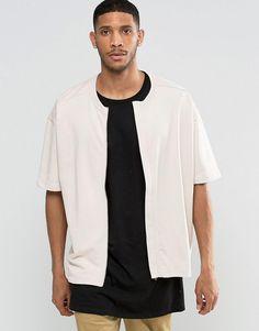 Pink   ASOS Oversized Short Sleeve Jersey Bomber Jacket In Pink at ASOS