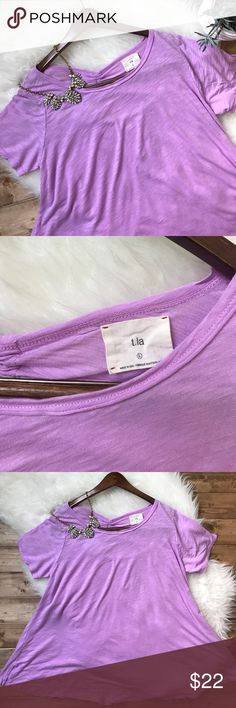 """• ANTHROPOLOGIE T.la lilac tie back tunic • T.la for Anthro. Cotton/modal fabric. Super soft. Open tie back. So so sweet paired with jeans. I'm a size small and I wore it oversized comfortably! But fits a size large beautifully as well! Bust: 21"""" Length: 27"""" Anthropologie Tops Tunics"""