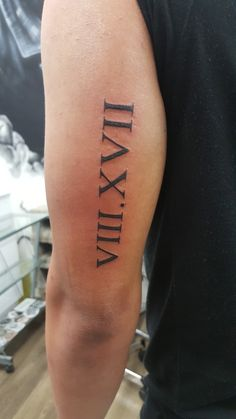 Roman neumeral tricep men august 17 Tricep Tattoos, Forearm Band Tattoos, Forarm Tattoos, Arm Sleeve Tattoos, Forearm Sleeve, Cool Chest Tattoos, Cool Tattoos For Guys, Mens Roman Numeral Tattoo, Roman Numerals