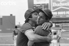 Reds' Johnny Bench Kissing Mets' Tom Seaver  7/13/1983-New York, NY: Mets' Tom Seaver is very surprised as Reds' Johnny Bench grabs and kisses him after overhearing all the nice things that Seaver was saying about Bench to the sports writers.