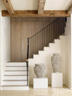 Wood paneling along the three-story staircase adds dimension to the space.